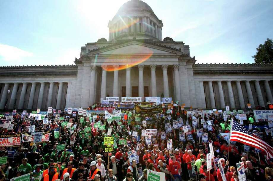 Thousands of protesters gather on Friday, April 8, 2011 on the State Capitol Campus in Olympia. A crowd estimated by the Washington State Patrol at around 7,000 people gathered on the steps of the Capitol to protest for an end to corporate tax breaks and cuts to public programs. Photo: JOSHUA TRUJILLO / SEATTLEPI.COM