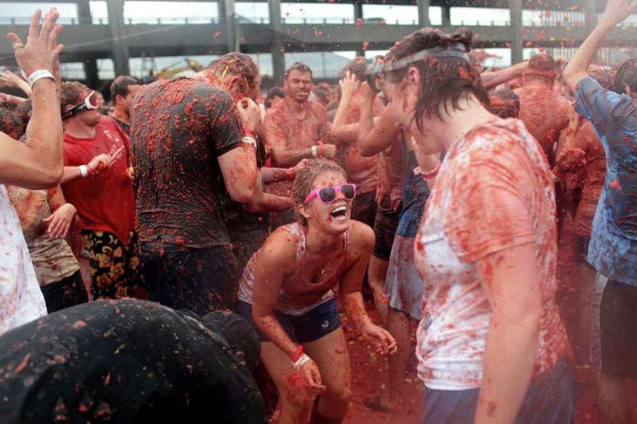 Hundreds of people waged a crimson war with over 300,000 pounds of overripe tomatoes at the Seattle Tomato Battle on Saturday, September 23, 2011, at the Pyramid Brewery in Seattle. The event was complete with a beer garden, battle of  the bands competition and a host of sponsors. Photo: JORDAN STEAD / FOR SEATTLEPI.COM