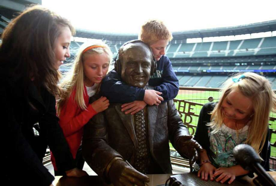 From left, Destiny Niehaus, 17, Maddie Dunn, 10, Steven Dunn, 12 and Lexi Niehaus, 8, gather around a statue of their late grandfather, Dave Niehaus, during the unveiling of the bronze monument to the voice of the Mariners. Niehaus, who died in 2010, was the broadcast voice of the team for decades. Photographed on Friday, September 16, 2011 at Safeco Field. Photo: JOSHUA TRUJILLO / SEATTLEPI.COM