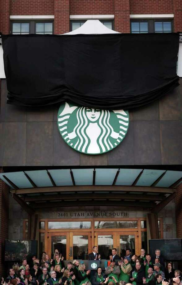 "Starbucks unviles an updated corporate logo during a 40th anniversary celebration for the Seattle-based coffee company on Tuesday, March 8, 2011 at headquarters in the SoDo neighborhood. The word ""Starbukcs"" is gone from the new logo. Photo: JOSHUA TRUJILLO / SEATTLEPI.COM"