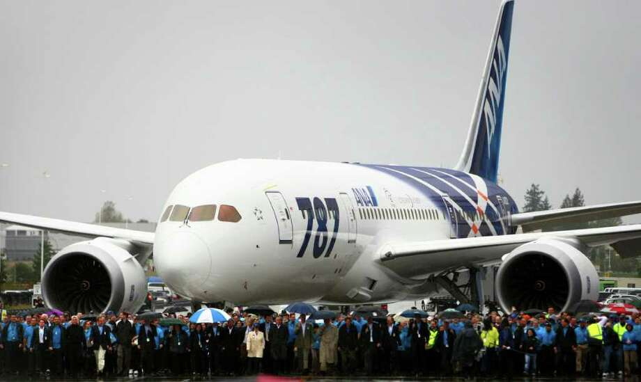 Boeing workers lead a 787 toward a ceremony marking delivery of the first Boeing 787 to launch customer All Nippon Airways on Monday, September 26, 2011 at the Boeing plant in Everett. Photo: JOSHUA TRUJILLO / SEATTLEPI.COM