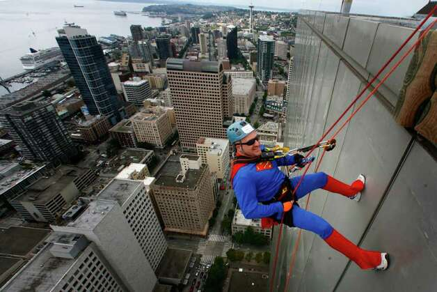 Craig Norris, dressed as Superman, begins his descent of Seattle's 41-story Rainier Square Tower during Over the Edge, a fundraiser for Special Olympics Washington, on Saturday, August 13, 2011 in Seattle. Nearly 200 people who raised money for Special Olympics Washington rappelled down the 514-foot tall building. Photo: JOSHUA TRUJILLO / SEATTLEPI.COM