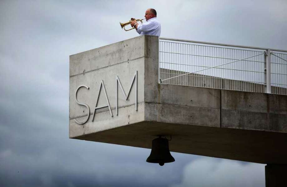 A man practices his fluegelhorn during the lunch hour on Thursday, June 30, 2011 at the Olympic Sculpture Park in Seattle. Photo: JOSHUA TRUJILLO / SEATTLEPI.COM