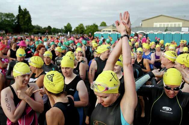 Swimmers prepare to start the Danskin Triathlon at Genesee Park in Seattle on Sunday August 14, 2011. Photo: JOE DYER / SEATTLEPI.COM