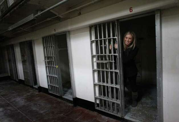 Amanda Owens, who was raised on McNeil Island, poses for a photo in a cell during the closing ceremony for McNeil Island Corrections Center on Thursday, March 3, 2011. Her father was a corrections officer on the island from 1983 to 2000. Many families lived on the island, which had a school and other elements of a community. McNeil Island housed inmates since 1875 and in 1904 became a federal prison. It eventually became part of the Washington State prison system and was closed due to budget cuts. The remaining inmates were distributed to other Washington facilities. Photo: Joshua Trujillo / SEATTLEPI.COM