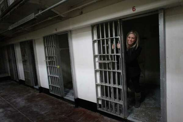 Amanda Owens, who was raised on McNeil Island, poses for a photo in a cell during the closing ceremony for McNeil Island Corrections Center on Thursday, March 3, 2011. Her father was a corrections officer on the island from 1983 to 2000. Many families lived on the island, which had a school and other elements of a community. McNeil Island housed inmates since 1875 and in 1904 became a federal prison. It eventually became part of the Washington State prison system and was closed due to budget cuts. The remaining inmates were distributed to other Washington facilities.