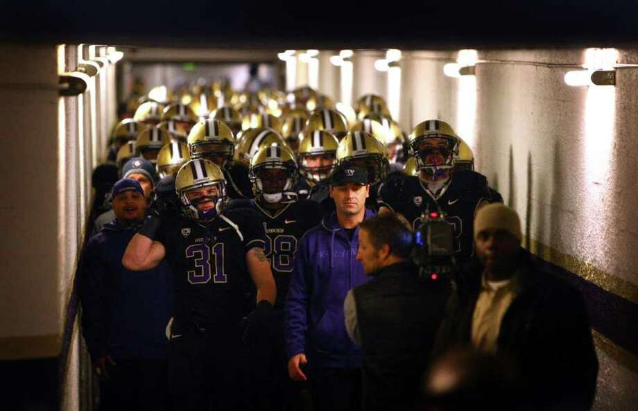 Football players, led by head coach Steve Sarkisian walk down the tunnel to take the field for the last time at the old Husky Stadium during a game against the Oregon Ducks on Saturday, November 5, 2011. The game was the last to be held at the aging stadium. The stadium was going to be overhauled and modernized. Photo: JOSHUA TRUJILLO / SEATTLEPI.COM