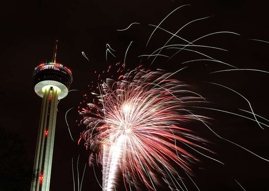Fireworks erupt near the Tower of Americas to celebrate the New Year in 2011. Photo: Express-News File Photo / kmhui@express-news.net