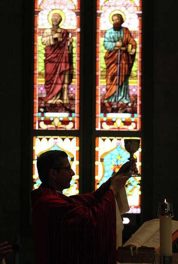 San Antonio Archbishop Gustavo Garcia-Siller presents the Communion chalice during noon Mass at S