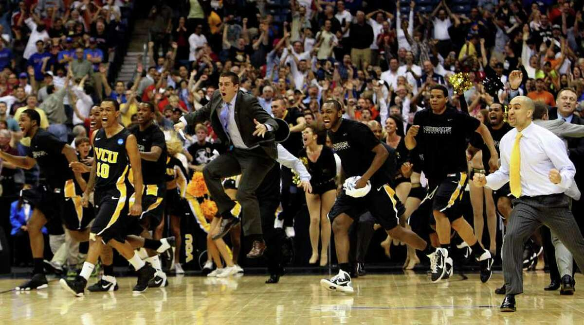 The Virginia Commonwealth team, including coach Shaka Smart, right, storm the court during the NCAA Southwest Regional Semifinals in San Antonio, Texas on Friday, March 25, 2011 after VCU's vicotry over Florida State. VCU won 72-71 in overtime to advance to the Elite 8 for the first time in school history.