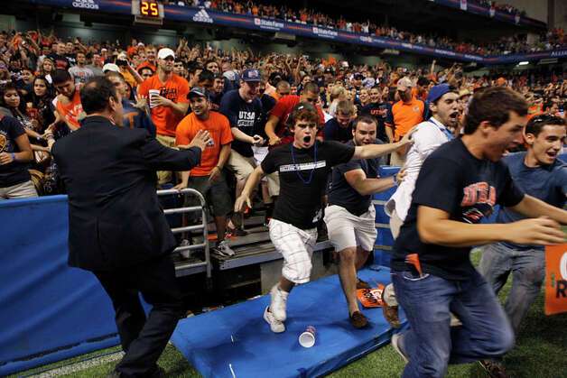 Fans rush the field at the conclusion of UTSA's inaugural football game against Northeastern State at the Alamodome on Saturday, Sept. 3, 2011. Photo: LISA KRANTZ, Lisa Krantz / SAN ANTONIO EXPRESS-NEWS