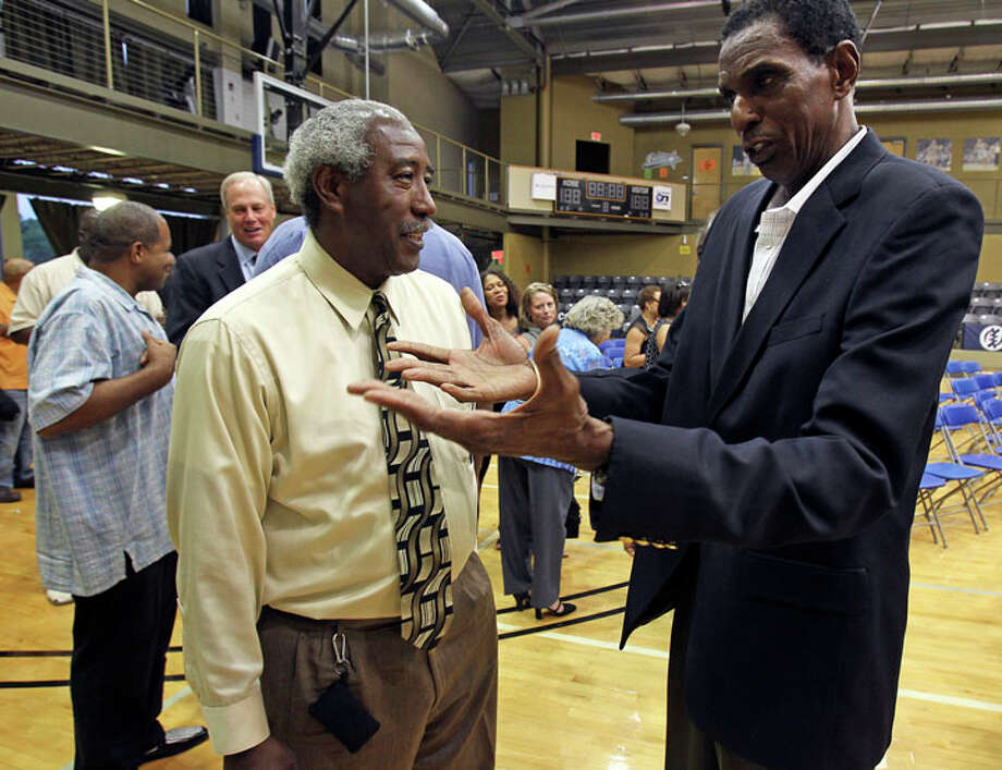 Spur teammates Mike Gale and Larry Kenon talk after the memorial service for Spurs great Mike Mitchell at the Antioch Sports Center  on  June 16, 2011.  Paul Griffin can be seen in the background. Photo: TOM REEL, Tom Reel / © 2011 San Antonio Express-News