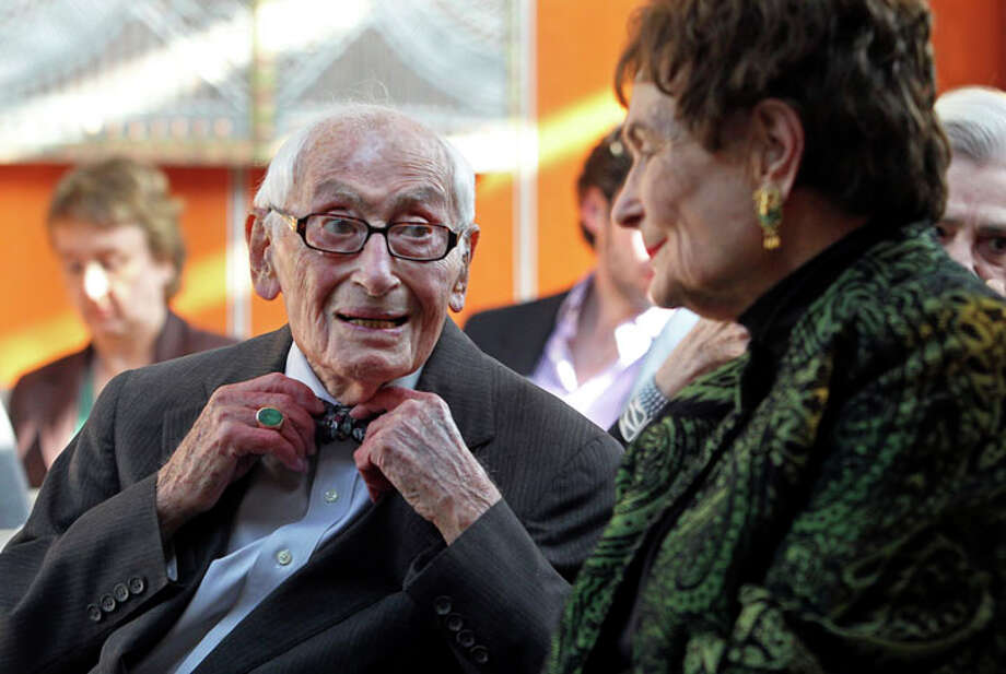 Bill Sinkin straightened his bow tie while talking with former mayor Lila Cockrell as he is honored at the Tower of the Americas with a portrait by Robert Wilkins  on March 15, 2011. Photo: TOM REEL, Tom Reel / © 2011 San Antonio Express-News