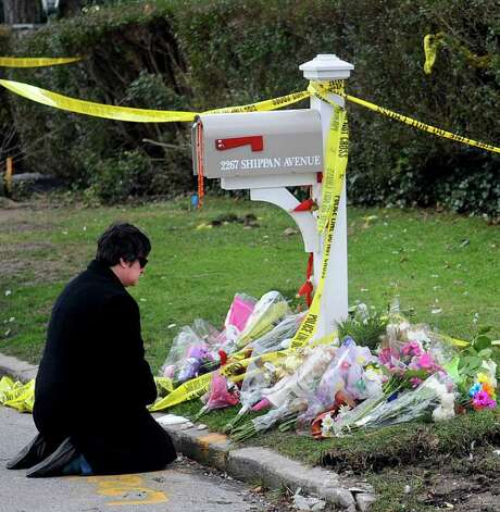 "Cindy Farrell of Albany, N.Y., kneels to pray in front of 2267 Shippan Ave. on Wednesday, December 28, 2011, where a fire on Christmas morning killed three children and their grandparents. ""My heart is breaking for the family,"" she said. Farrell said she was in town for business and wanted to stop by and pay her respects. ""I just feel really horrible and I just wanted to pay my respects and send prayers."" Farrell added that she asked her sister to add the family to her prayer list as well. Photo: Lindsay Niegelberg / Stamford Advocate"