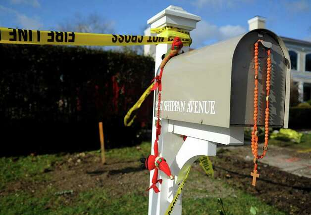 Rosary beads hang from the mailbox at 2267 Shippan Ave. on Wednesday, December 28, 2011, where a fire on Christmas morning killed three children and their grandparents. Photo: Lindsay Niegelberg / Stamford Advocate