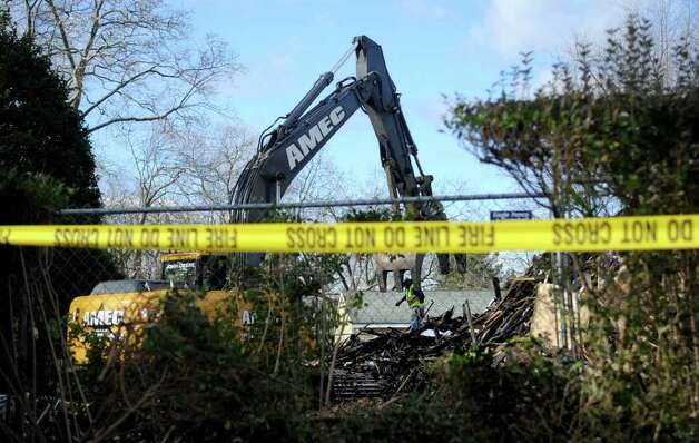 Debris is removed from 2267 Shippan Ave. on Wednesday, December 28, 2011, where a fire on Christmas morning killed three children and their grandparents. Photo: Lindsay Niegelberg / Stamford Advocate