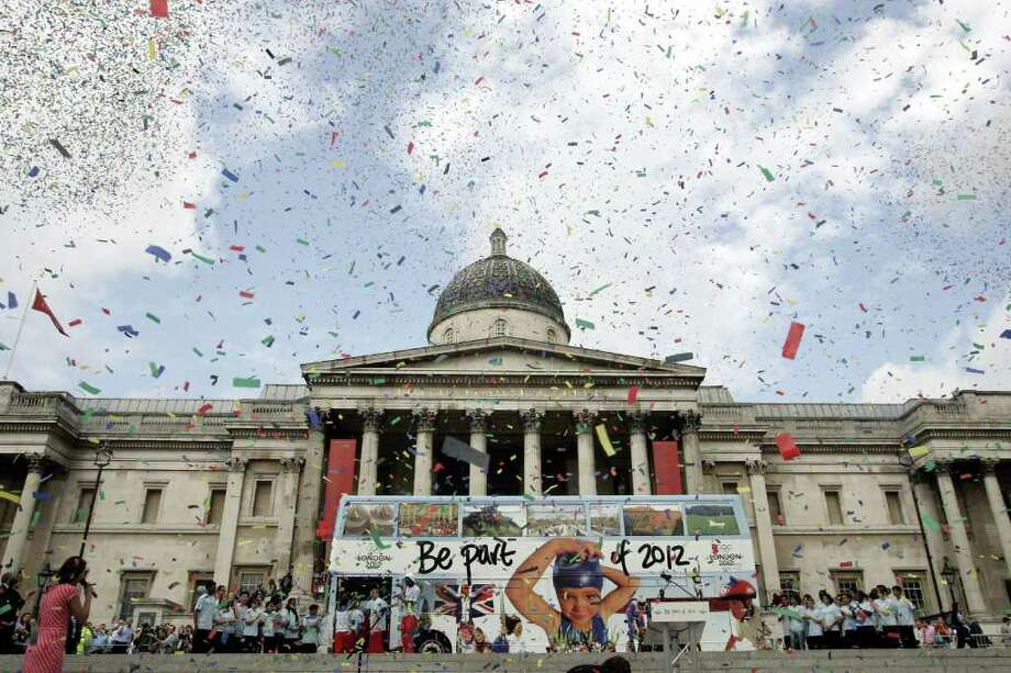 FILE-   In this July 6, 2006 file photo, Confetti is released over central London's Trafalgar Square, during an event to mark the first anniversary of the announcement that the capital will host the Olympic and Paralympic Games in 2012. The Summer Olympic Games will take place  July 27-Aug. 12. Photo: AP