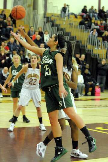 Shen's Alyssia Marsal goes in for a layup  during their high school girls basket ball game against C