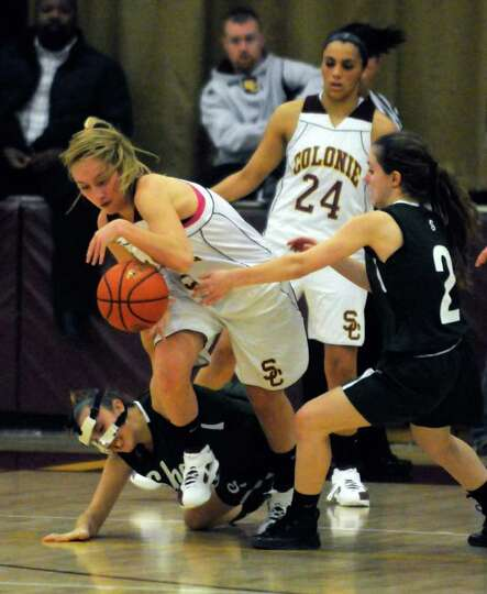 Colonie's Ashley Loggins steals a ball which led to her going the length of the court for a score du