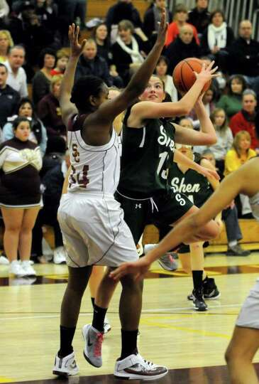 Shen's Ali Lewis goes to the basket during their high school girls basket ball game against Colonie