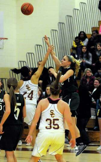 Shen's Emily Weber takes a shot defended by Colonie's Sydnie Rosales during their high school girls