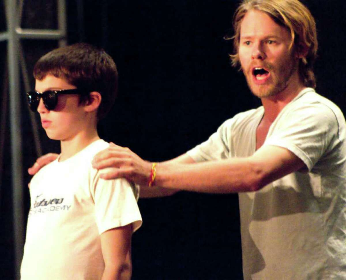 """Connor McNinch as Tommy, at age 10, and Randy Harrison as Tommy/The Narrator in rehearsal for the Berkshire Theatre Festival's new production of """"The Who's Tommy,"""" directed by Eric Hill. (Christy Wright photo)"""