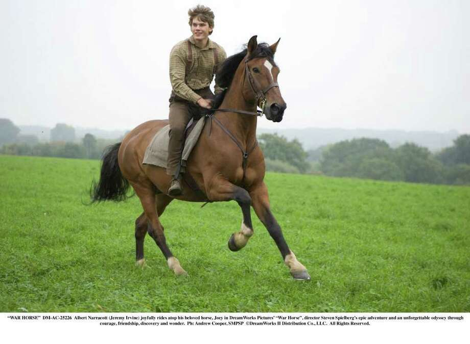 """GORGEOUS IMAGERY WITH AN EDGE: Actor Jeremy Irvine rides """"Joey"""" in """"War Horse."""" Cinematographer Janusz Kaminski reflected the beauty and harshness of the land. Photo: DREAMWORKS / ©DreamWorks II Distribution Co., LLC.  All Rights Reserved."""