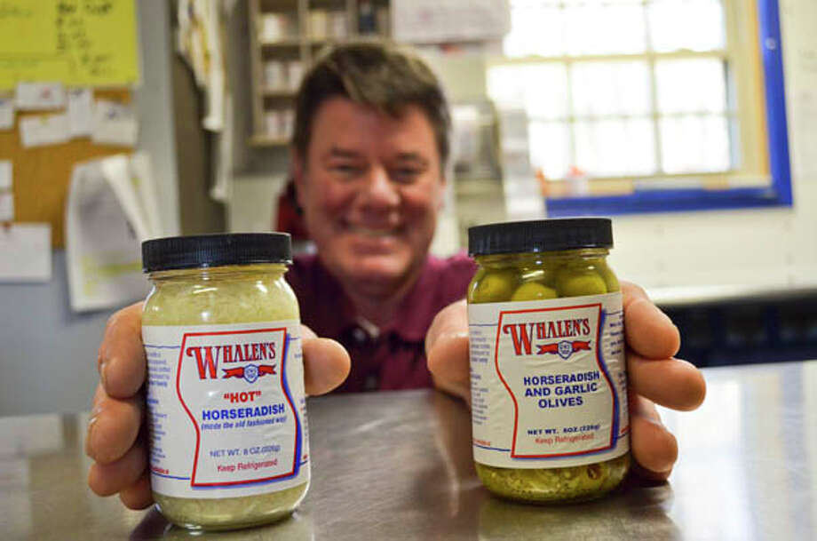 Dan Bell, owner of Whalen's Horseradish Products, is up to his elbows in horseradish. Since buying the business in 1997, Bell has added over 23 spicy products to the company's line. (Photo by Tyler Murphy/Life@Home) Read the story here.
