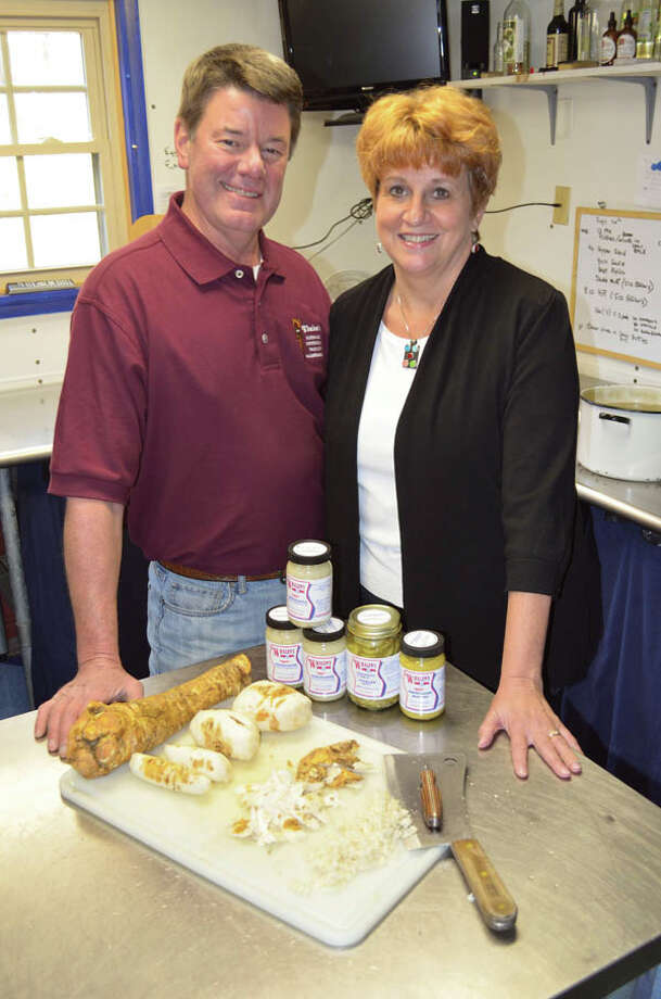 Dan Bell, owner of Whalen's Horseradish Products, is up to his elbows in horseradish. Since buying the business in 1997, Bell has added over 23 spicy products to the company's line. (Photo by Tyler Murphy/Life@Home)  Read the story