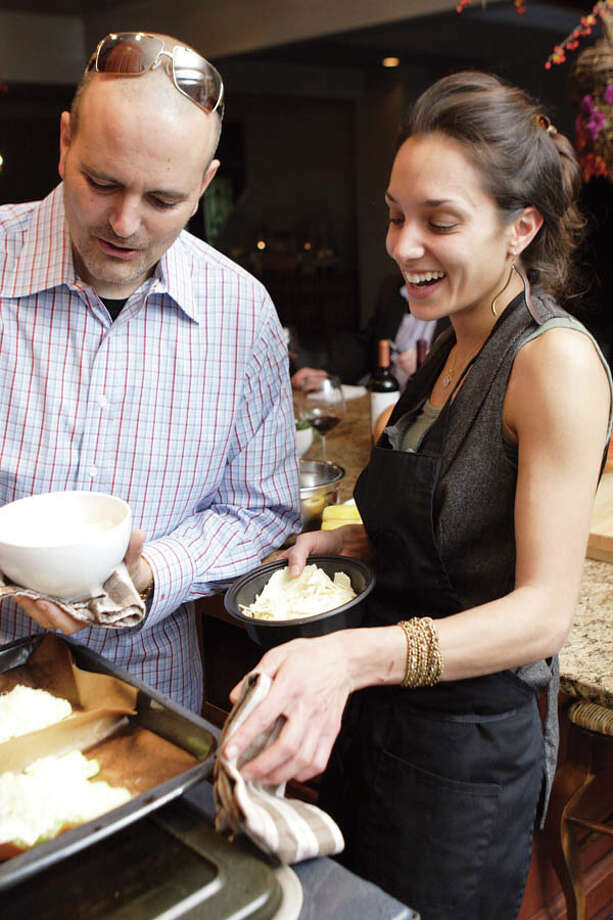David and Roslyn Zecchini cook together easily, fluidly, complementing one another?s movements as they chat with friends. (Photo by Suzanne Kawola/Life@Home)  Read the story