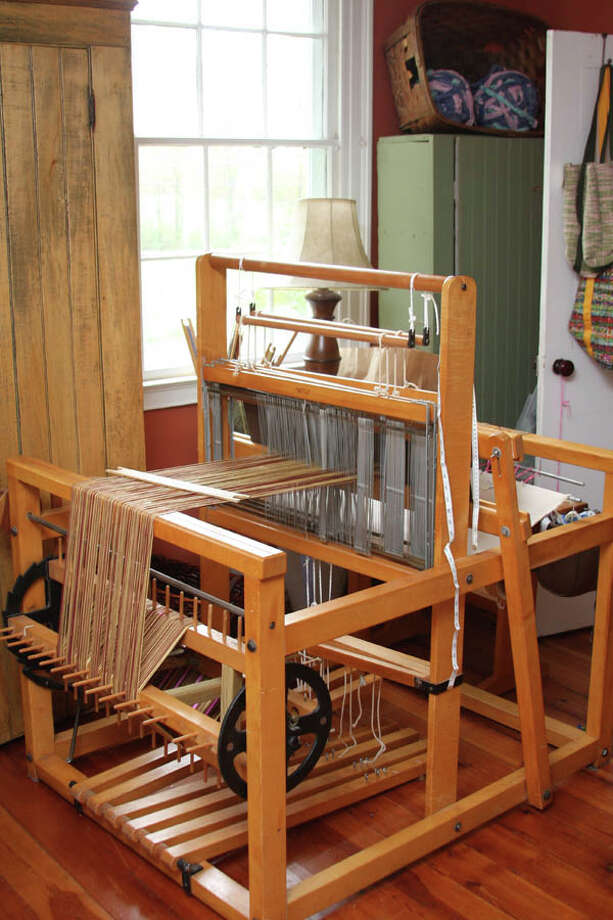 Hilary Cooper-Kenny followed her passion to become a full-time professional weaver with a mission of recycling used materials.  (Photo by Paul Barrett/Life@Home) Read the story
