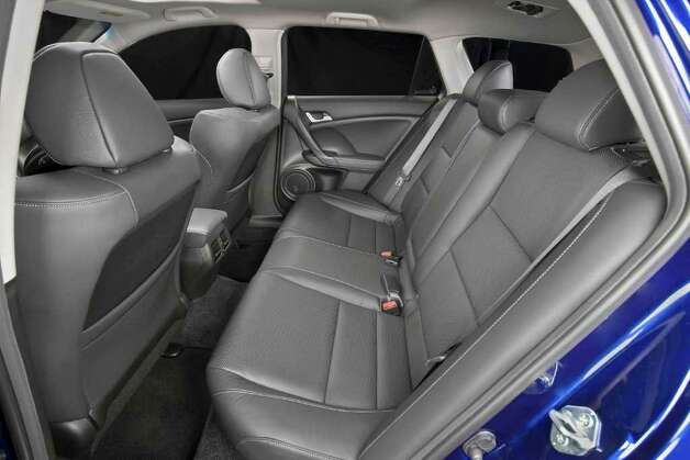The rear seat of the TSX Sport Wagon seats up to three people, and the seatback can be folded down to expand the cargo area. COURTESY OF AMERICAN HONDA MOTOR CO. Photo: American Honda Motor Co., COURTESY OF AMERICAN HONDA MOTOR CO. / Acura