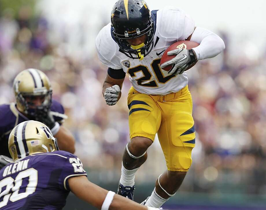 California's Isi Sofele, right, leaps to gain ground on a run as Washington's Justin Glenn moves in in the first half of an NCAA college football game, Saturday, Sept. 24, 2011, in Seattle. (AP Photo/Elaine Thompson)  Ran on: 11-19-2011 If Isi Sofele thrives, the Bears can control the clock and limit Stanford's offense. Photo: Elaine Thompson, ASSOCIATED PRESS