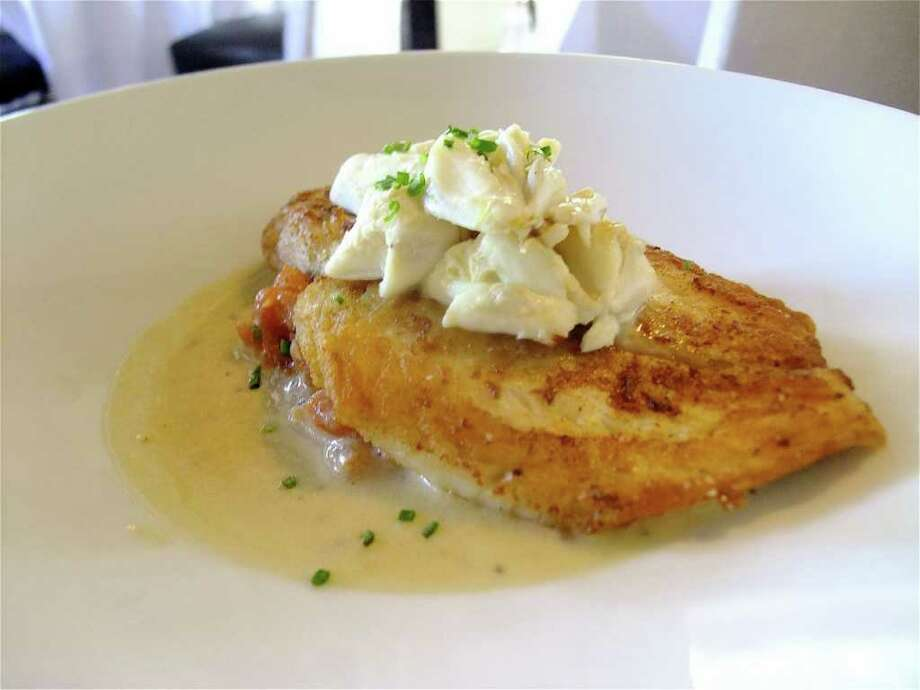 Cinq offers Gulf snapper with lump crab, tomato compote and lemon butter. Photo: Alison Cook / Houston Chronicle
