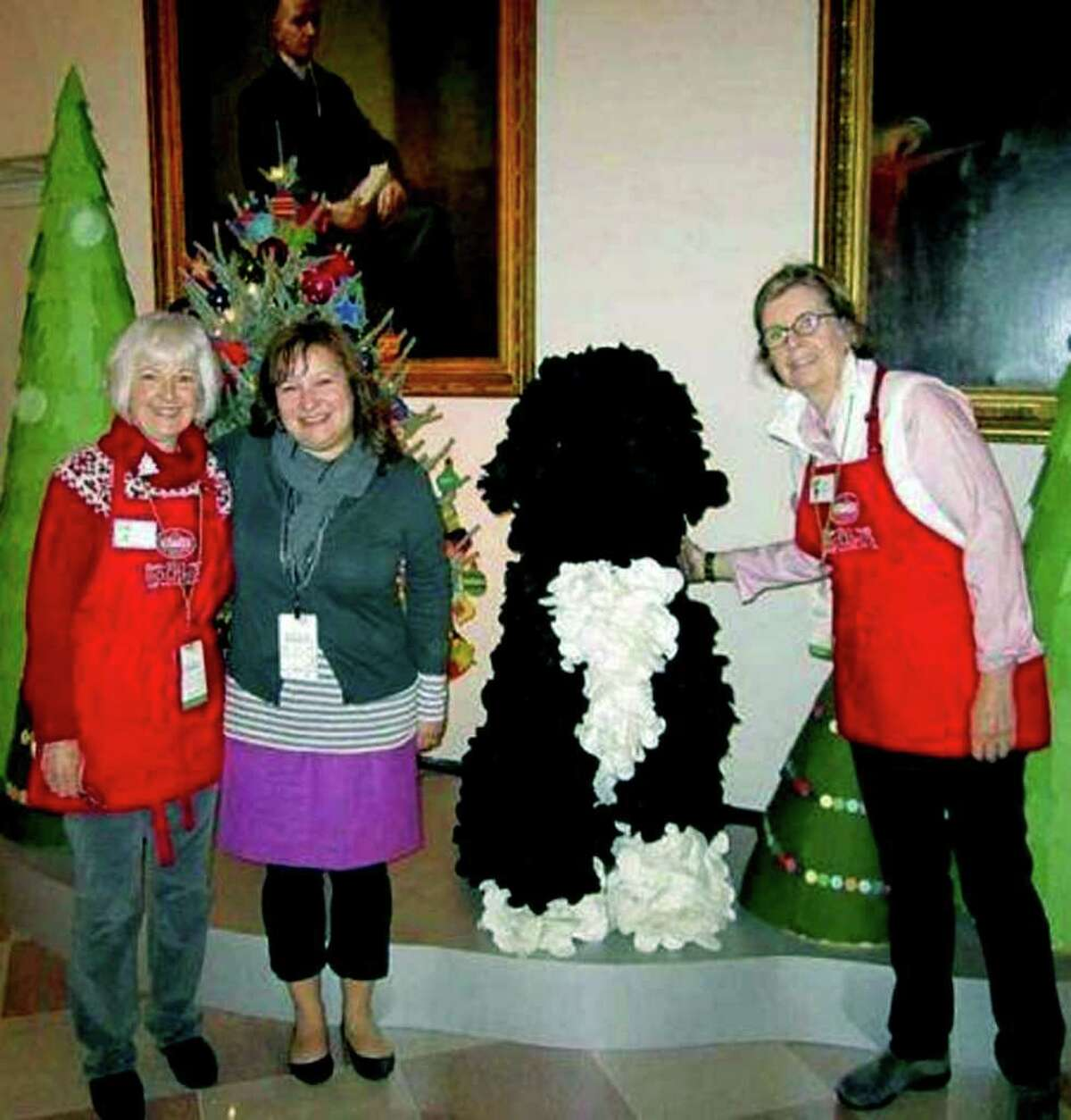 SPECTRUM/Eileen Mulvihill, right, of New Milford poses with longtime friend Karen Corcoran, left, and designer Jami Darwin Chiang, during their work time at the White House. December 2011 Courtesy of Karen Corcoran