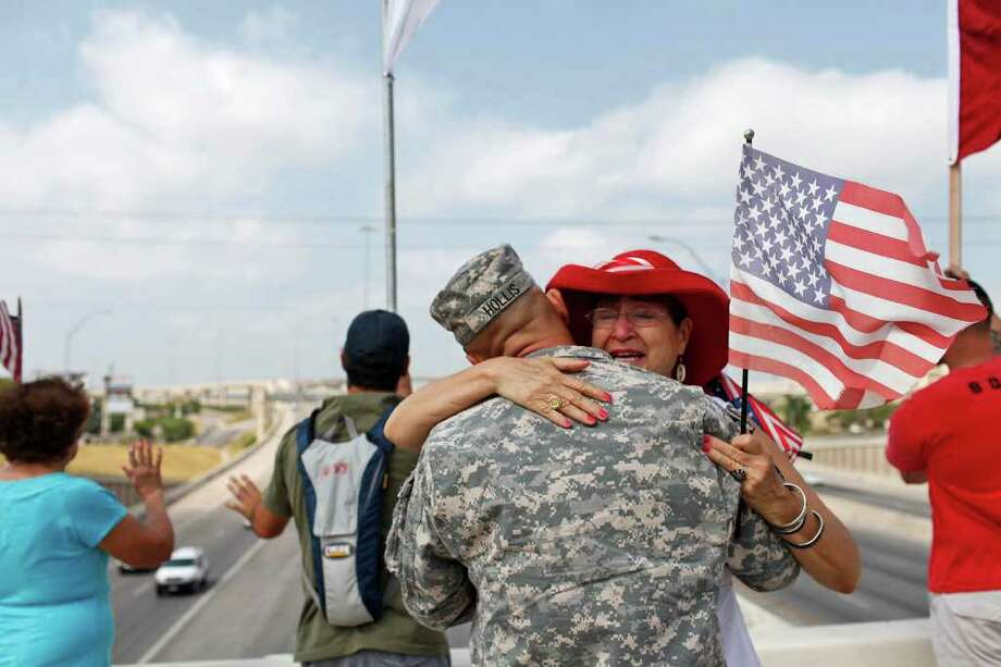 Sgt. Don Hollis, returning from Iraq, hugs Gold Star Mother Mary  Aguirre. Krantz says this is the type of story she feels privileged to capture and share. Photo: Staff, Lisa Krantz / SAN ANTONIO EXPRESS-NEWS