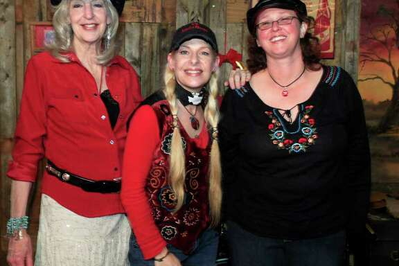 Susan Taylor (from left), Katherine Dawn and Ginger Pickett get together during the Texas Music Coalition Holiday Party Showcase at The Hangin' Tree Saloon.