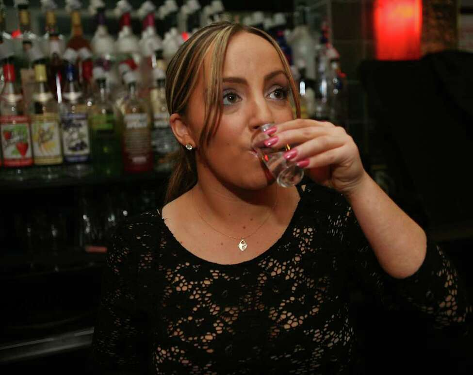 Bartender Jessica Smith of Stratford taste tests six vodkas at the Bubble Lounge at 50 Sanford Street in Fairfield.