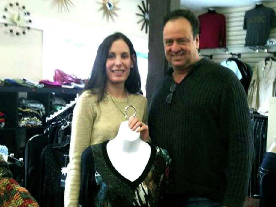 SPECTRUM/Jennifer Carbone and her husband, David, are owners of the new Designer Garage Boutique, located in a renovated former tobacco barn they purchased two years ago in New Milford. The Bethel couple sell high end designer clothing and furniture at outlet-style prices. December 2011  Photography by Nanci Hutson Photo: Contributed Photo