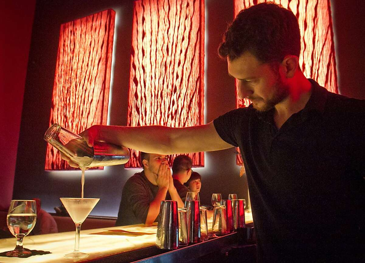 Bartender Thom Talone pours a drink at Amber India in San Francisco, Calif., on Saturday, December 17th, 2011.
