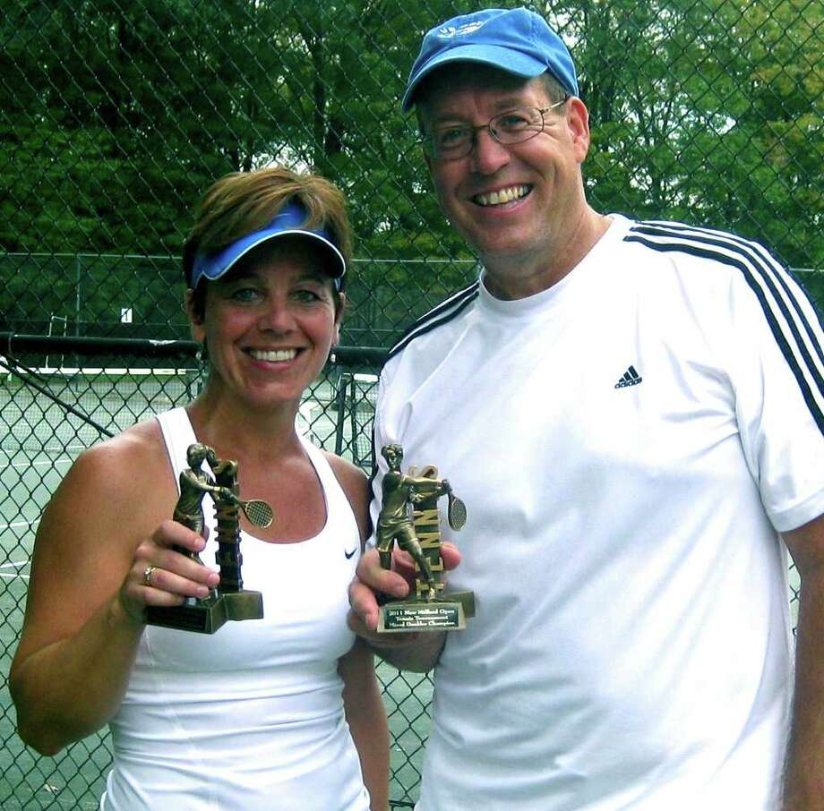 SPECTRUM/Unseeded Patricia Dengler of New Milford and David Riddle of Gaylordsville recently captured the mixed doubles title as part of the annual New Milford open tennis tournament.  2011  Courtesy of Todd Nicholson Photo: Contributed Photo