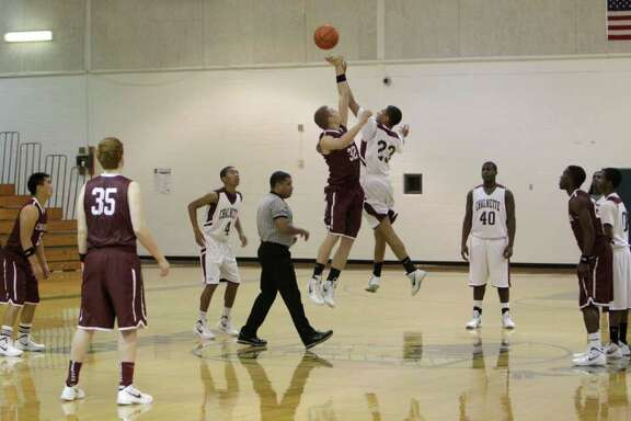 As a tribute, the Cinco Ranch basketball team started with only four players Wednesday, Dec. 28, 2011, in Alvin, for the tip-off of the team's first game since the death of player Chris Saiz. Saiz,16, died in a car accident on Dec. 20. The team played the Chalmette Owls from Louisiana in the Alvin Noon Lions Club 25th Annual Holiday Classic Basketball Tournament at Harby Middle School, 1500 Heights Road.