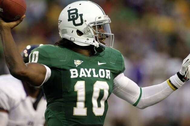 Baylor quarterback Robert Griffin III (10) prepares to pass against Stephen F. Austin in the first half of an NCAA college football game, Saturday, Sept. 17, 2011, in Waco, Texas. Photo: AP
