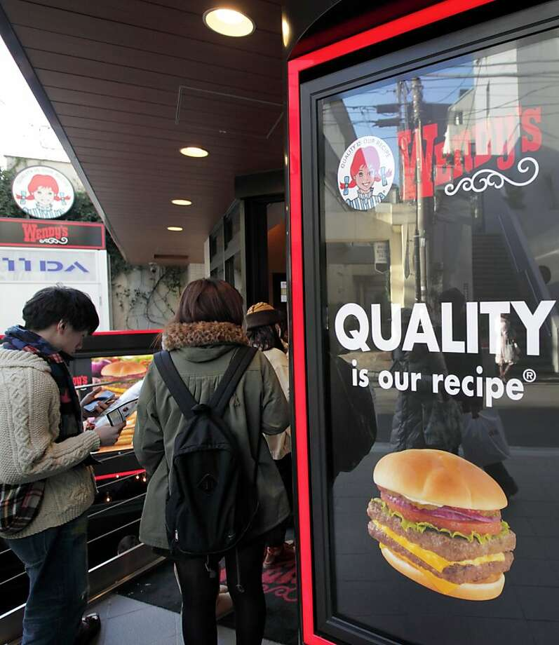 Customers wait outside a Wendy's restaurant in the Omotesando district of Tokyo, Japan, on Wednesday, Dec. 28, 2011. Wendy's Co., the third-biggest U.S. fast-food chain, is adding goose-liver pate and truffles to burgers as it invests as much as $200 million on a return to Japan after leaving the country in 2009. Photographer: Tomohiro Ohsumi/Bloomberg Photo: Tomohiro Ohsumi, Bloomberg