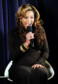 "Singer Beyonce Knowles introduces ""Beyonce Live At Roseland: The Elements of 4"" live concert film at a special screening for fans at the Paris Theatre on Sunday, Nov. 20, 2011 in New York. (AP Photo/Evan Agostini) Photo: Evan Agostini, ASSOCIATED PRESS / AP2011"