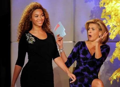 "In this photo provided by NBC Universal,  Singer Beyonce Knowles suprise's ""Today"" show co-host Hoda Kotb during a fashion segment on NBC's ""Today"" show, in New York, on Wednesday, Oct. 6, 2010. Photo: Peter Kramer, AP / NBC Universal"