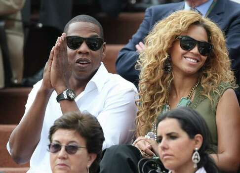 Singers Jay-Z and Beyonce watch Spain's Rafael Nadal playing Sweden's Robin Soderling during the men's final match of  the French Open tennis tournament at the Roland Garros stadium in Paris, Sunday, June 6, 2010. Photo: Lionel Cironneau, AP / AP