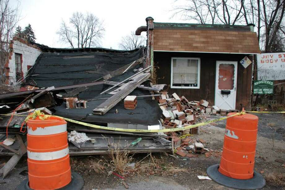 The building of Jay Street Body Works on Newton Street in Colonie collapsed in January and remains in an unstable condition nearly a year later. (Yi-Ke Peng / Times Union)