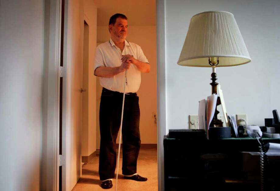 In a Tuesday, Dec. 20, 2011 photo, Hurricane Katrina victim David Bellinger stands in his apartment, in Atlanta. When the Federal Emergency Management Agency mailed out roughly 83,000 debt notices this year to victims of the destructive 2005 hurricane season, one of the letters showed up in Bellinger's mailbox. Bellinger is blind, so a friend read it and broke the news that FEMA wants him to pay back more than $3,200 in federal aid he received after Hurricane Katrina. Photo: AP