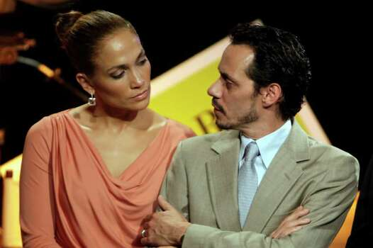"In this Friday March 4, 2011 picture, Jennifer Lopez, left, and husband Marc Anthony attend a signing ceremony for filmmaking incentive legislation for the U.S. island territory in Bayamon, Puerto Rico. The superstar couple announced Friday, July 15, 2011 they are breaking up. The two married in 2004 and have 3-year-old twins, Max and Emme. In a Friday statement from her publicist, the pair called the decision to end their marriage a ""very difficult decision."" They say they have come to an ""amicable decision"" on all matters and ask for privacy. It's Lopez's third marriage, Anthony's second. (AP Photo/Ricardo Arduengo) Photo: Ricardo Arduengo / AP2011"